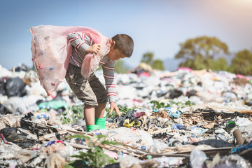 Poor children collect garbage for sale because of poverty, Junk recycle, Child labor, Poverty concept, World Environment Day, Fotomurales