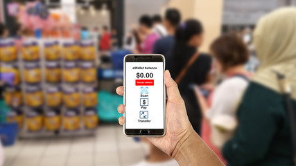 Smartphone with  E Wallet app while queuing at the cashier counter.