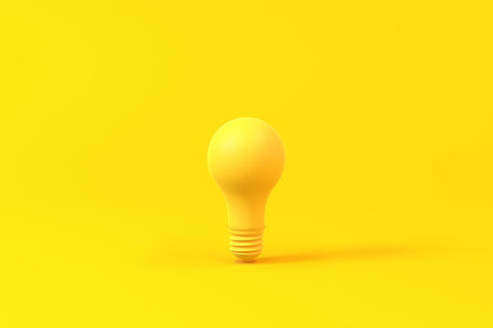 Light bulb isolated over a yellow background. Minimalist concept.