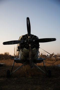Old Rusted Propeller Airplane Abandoned in Junkyard at the Airport