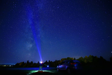 night scenery of a star and a machine, an adventure in the night scenery, the milky way above travelers
