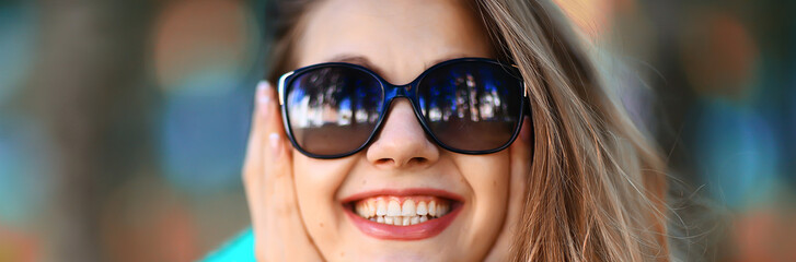 cheerful blonde in sunglasses / young beautiful girl, sunglasses, woman summer look Wall mural