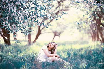 girl spring / portrait of a beautiful girl in a spring blooming park, apple blossoms, beauty, cleanliness, freshness, the smell of spring