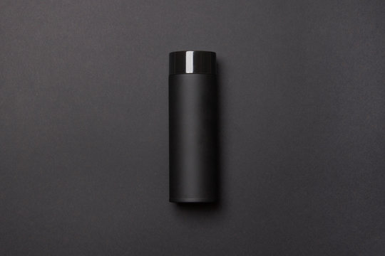black thermos cup on black background