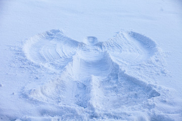 A snow angel made in the white snow.