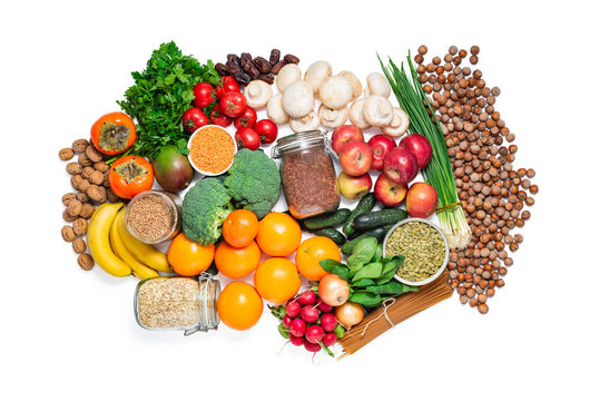 Variety of fruits, vegetables, grains, nuts and legumes isolated over white. Clipping path at 400%
