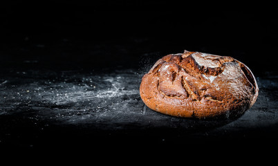 Deurstickers Brood Freshly baked bread on dark background