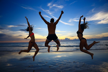 girl is having fun and jumping on beach freedom / concept freedom and summer  beach, sporty graceful girl is jumping and having fun  beach