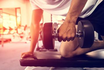 Men lifting dumbbells in the fitness.