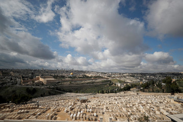 A general view of a Jewish cemetery on the Mount of Olives in the foreground and the Dome of the Rock located on the compound known to Muslims as Noble Sanctuary and to Jews as Temple Mount,  in Jerusalem's Old City