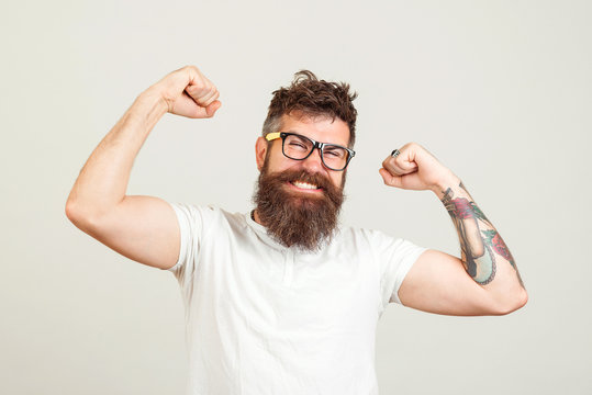 Handsome hipster guy sreaming yeah rejoicing in win. Happy winner, successful in business