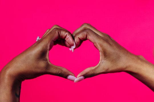 Black hands making heart shape