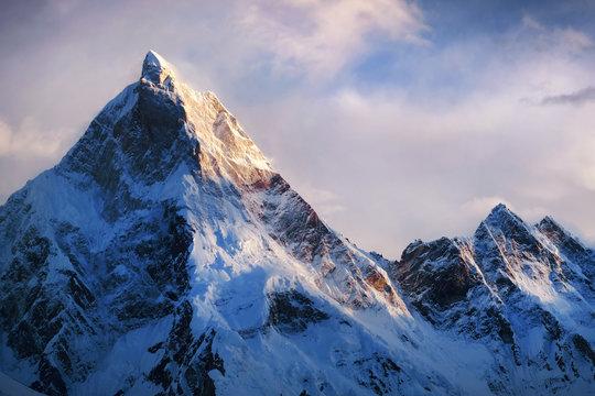 Panoramic view of beautiful snowy Masherbrum peak in Karakoram mountain range during sunset light