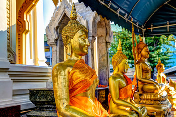 Wall Murals Place of worship The gold buddha and exterior details of the Wat Traimit temple in Bangkok
