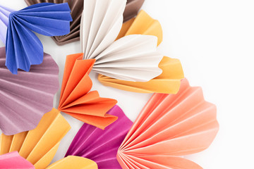 Close-up still life of multicolored paper hearts on white background