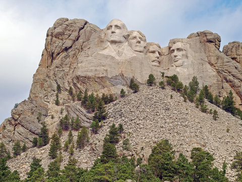 Iconic sculpted Presidential faces of George Washington, Thomas Jefferson, Theodore Roosevelt, and Abraham Lincoln  at the Mt. Rushmore National Memorial, Keystone, South Dakota