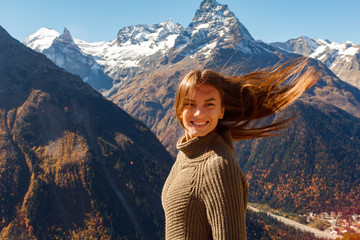 Nice Girl traveler in the background of the mountains
