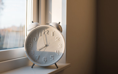 a large alarm clock sat on a window ledge of a home