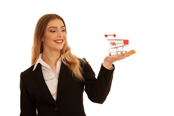 Young business woman holds a shopping cart in her hand isolated over white