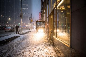 CITY STREET DURING snowfall