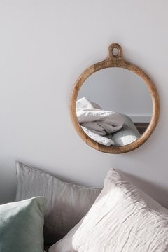 Reflection Of Crumpled Mattress Bed On Mirror At Home