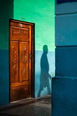 Shadow of man walking on wall