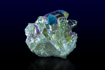 Titanium rainbow aura quartz crystal cluster.Close up