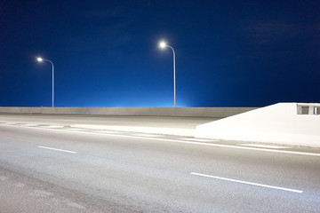 Empty Road Against Clear Blue Sky At Night Fotomurales