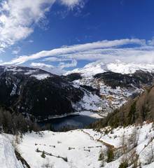 San Rocco, Madesimo, Sondrio, January 18, 2020 - Panoramic view on lake of Isola, taken from SS36 Lake Como and Spluga State Road. Panorama obtained by merging together 15 photos.