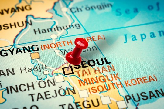 Pushpin pointing at Seoul city in South Korea