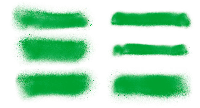 Green paint spray strokes brushes collection. Set of green brushes