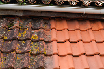 Obraz high pressure water cleaner tile after and before industrial roof cleaning - fototapety do salonu