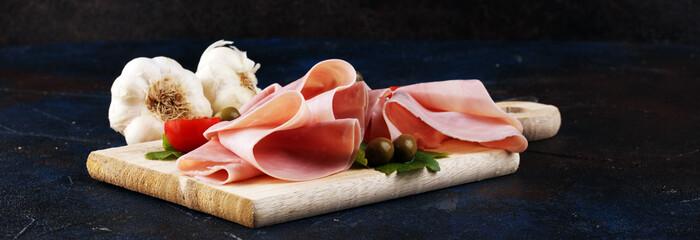 Fototapeta Sliced ham on wooden background. Fresh prosciutto cotto. Tasty Pork ham sliced obraz