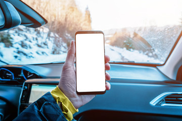 Phone mockup in the car passenger's hand. Isolated display to promote app design. The concept of using a phone in a car while traveling