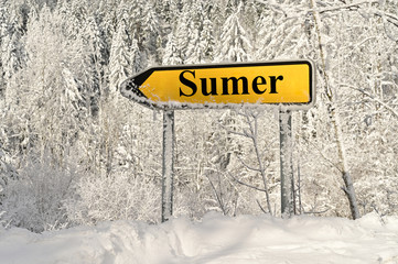 road sign arrow pointing to summer