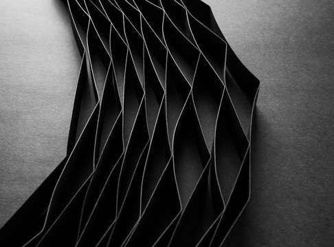 Abstract minimalist curve lines seamless modern architecture pattern made of black folded paper