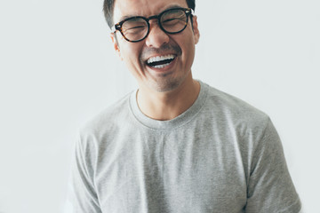 portrait young asian man wear eye glasses Smiling cheerful look thinking position with perfect clean skin posing on white background.fashion people freedom life style concept Papier Peint