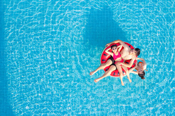 Asian family relax in swimming pool