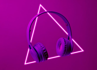 Fashinable headphones. 80's synth wave and retrowave glowing triangle futuristic aesthetics. Old fashioned abstraction concept