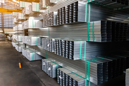 high quality Galvanized Square pipe or Aluminum and chrome stainless pipes in stack waiting for shipment  in warehouse