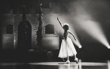 Photo of a beautiful ballerina in dance pose.