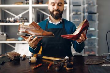 Bootmaker shows repaired shoes, footwear repair