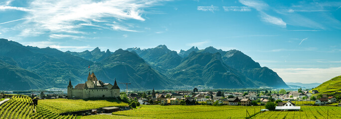 Panoramic view on city of Aigle with beautiful castle and Alps in background