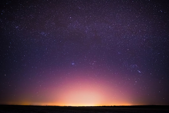 Real Night Sky Stars Background With Natural Colourful Sky Gradient. Sunset, Sunrise Light And Starry Sky. Yellow And Magenta Colors