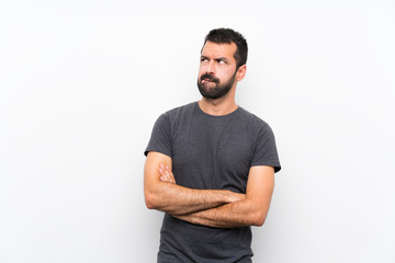 Young handsome man over isolated white background with confuse face expression Papier Peint