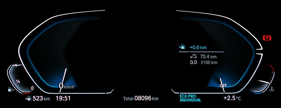 Empty illuminated car dashboard panel concept. Modern fully digital LCD instrument cluster without gauge needles and digits. Close up of two blank speedometer and tachometer circle dials at night.
