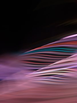 Close-Up Of Colorful Light Trails Against Black Background