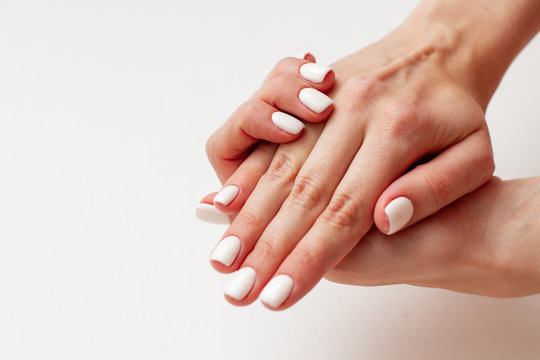 gentle female hands with a beautiful gel polish manicure