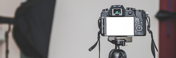 Banner, Mock up of a professional camera, in a photo studio, against the background of softbox light sources.