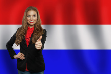 Love Netherlands! Happy cute woman smiling and showing thumb up